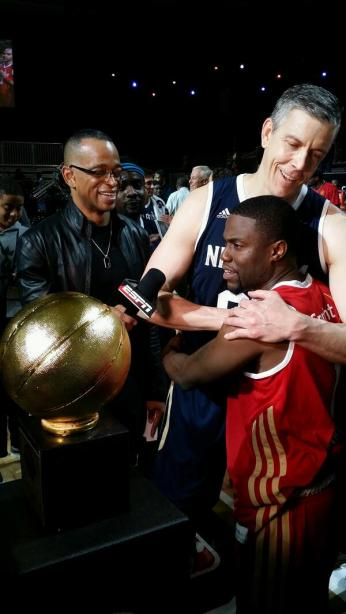 """Kevin Hart, the fan voted MVP, gives US Sectretary of Education Arne Duncan  the MVP Trophy, says he is the """"true MVP"""" of the 2014 NBA All-Star Celebrity Game"""